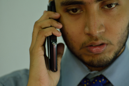 Businessman wearing formal wear talking over mobile phone