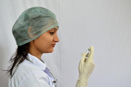 Nurse using injection for painting photo