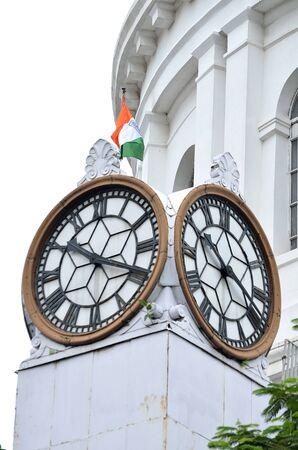white flag: A clock in a building at Kolkata.
