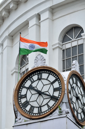 historical building: Indian flag and clock in old historical building at Kolkata