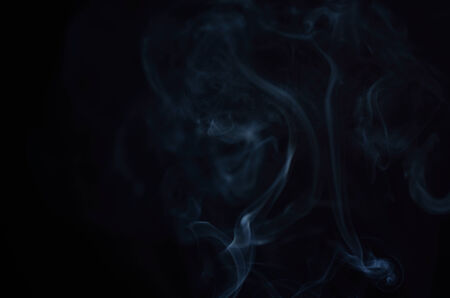 White smoke in black background. photo