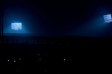 It situated at Kolkata, India. Stadium floodlights against a dark night sky background.  The picture is taken outside the stadium. From outside the stadium anyone can take the picture without any parmesan. I took the advantage and took the photograph. Фото со стока