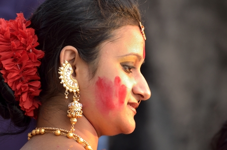 smearing: Bengali unmarried women participate in Sindur Khela smearing of the vermilion on Durga Pujas last day Bijoya Dashami. It is believed that Sindur khela dates back to time when the tradition of Durga puja started nearly 400 years ago.
