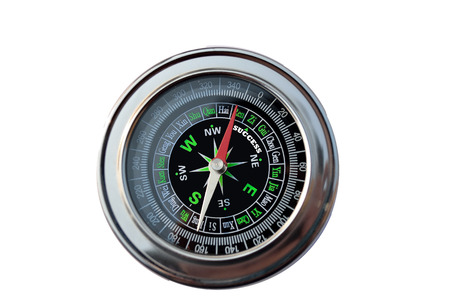 Vintage magnetic compass with arrow pointed to the success photo
