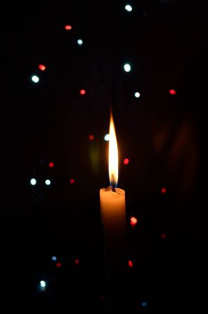 Composition With Burning Candle