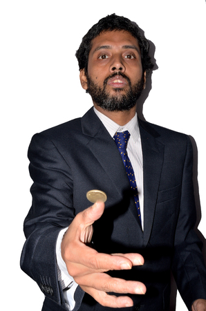 tossing: Businessman tossing a coin.