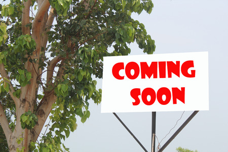 short phrase: Coming Soon concept written on a poster