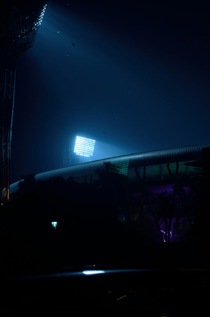 floodlit: It situated at Kolkata, India. Stadium floodlights against a dark night sky background. The picture is taken outside the stadium. From outside the stadium anyone can take the picture without any parmesan. I took the advantage and took the photograph.
