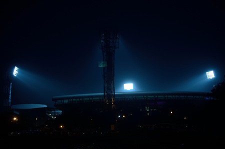 It situated at Kolkata, India. Stadium floodlights against a dark night sky background. The picture is taken outside the stadium. From outside the stadium anyone can take the picture without any parmesan. I took the advantage and took the photograph. photo