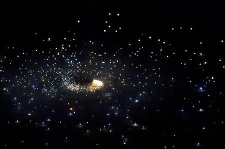 lightbeam: In a festival fireworks display in night