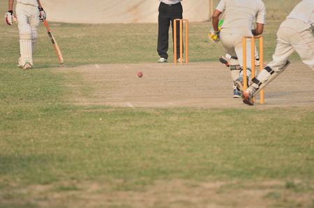 Cricket game was playing in field at Kolkata by boy photo