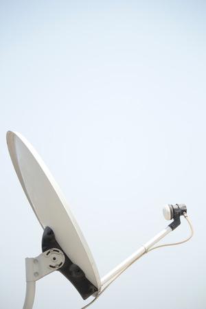 telecommunications equipment: Dish antenna over sky.
