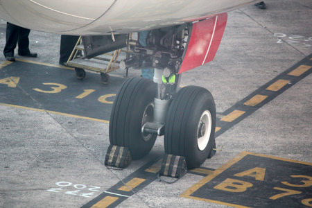Close-up of airplane wheels  in runway. photo