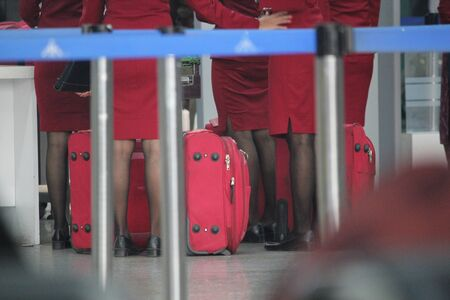 airplane cabin crew standing in queue photo