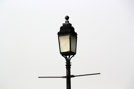 man made object: Old fashioned street light.