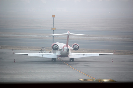 A plane is ready for departure at the airport in runway. photo