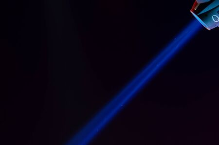 halogen lighting: Beam of blue light on black . Applied to a searchlight torch Stock Photo