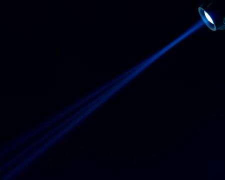 halogen lighting: Beam of blue light on black background. Applied to a searchlight, torch.