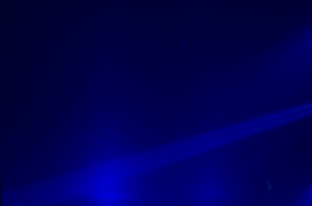 halogen lighting: Beam of blue light on black . Applied to a searchlight torch.