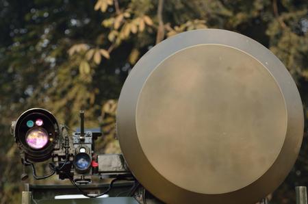 telecommunications equipment: Air surveillance radar in forest. Stock Photo