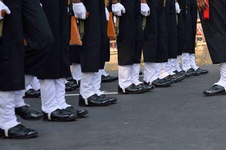 men standing: Indian army men standing with gun. Stock Photo
