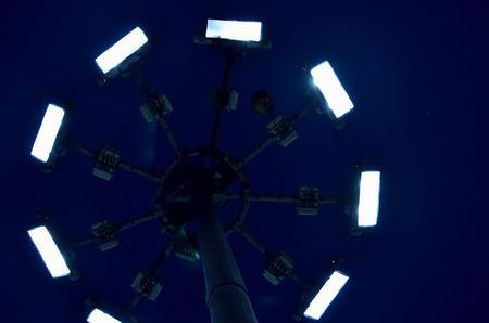 directly below: Lighting tower from low angle in a night. Stock Photo