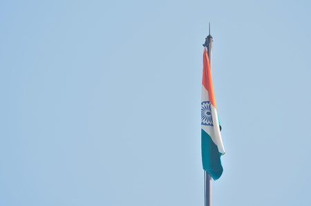 indian blue: Indian national flag is flying in a sky. Stock Photo
