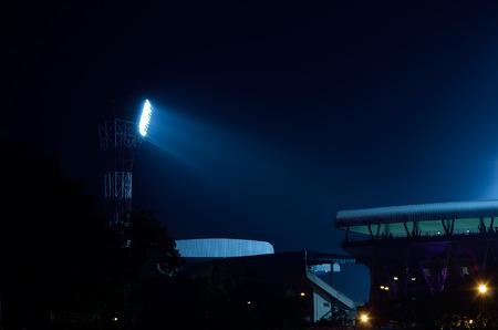 floodlit: It situated at Kolkata, India. Stadium floodlights against a dark night sky background.  Stock Photo
