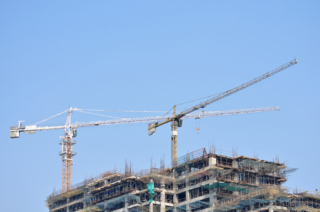 heavy equipment operator: Cranes in a construction site.
