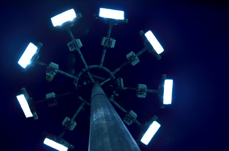 Lighting tower from low angle in a night. photo