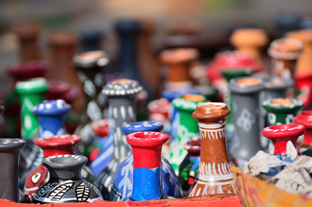 fare: Many painted vases displayed in a fare
