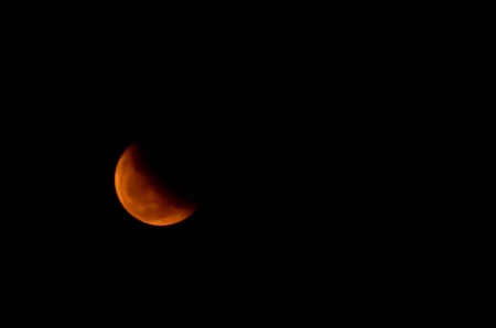 moon eclipse: moon eclipse. Red and Orange moon in a night sky.