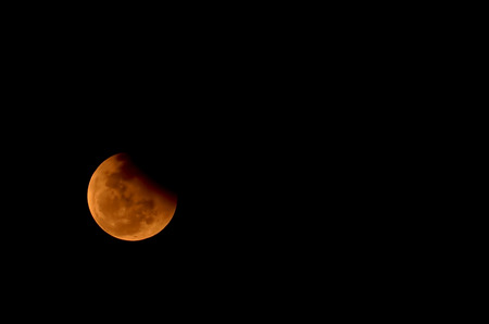 moon eclipse. Red and Orange moon in a night sky.