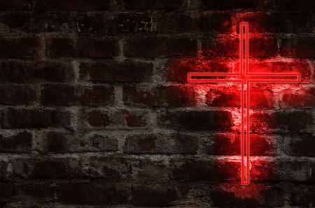 soul searching: Brick wall with Christian cross