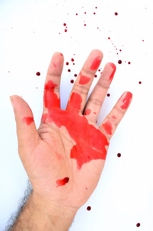 A bloodied hand in a white background with blood.