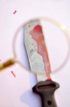 forensic: Forensic crime evidence. A bloody knife with fingerprint in white background.