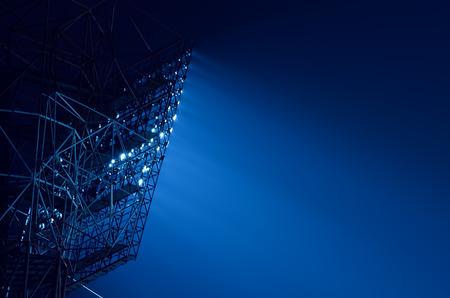 floodlights: Closeup of stadium floodlights against a dark night sky background