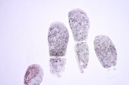 forensic science: Fingerprints in black on a paper. Stock Photo