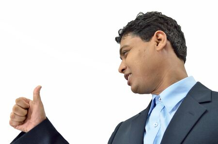 achivement: Man showing ok sign with his thumb up. Stock Photo