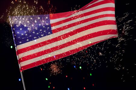 American Flag is flying and fireworks.