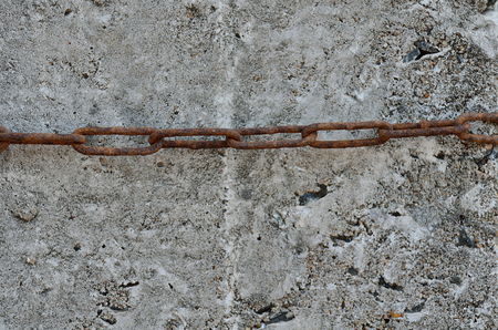 building a chain: A Chain in concrete texture of wall of a building.