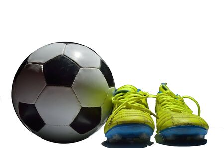 soccer cleats: Soccer ball and cleats on white background
