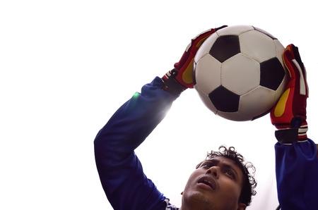 soccer goalkeeper: Soccer goalkeeper save goal in white background. Stock Photo
