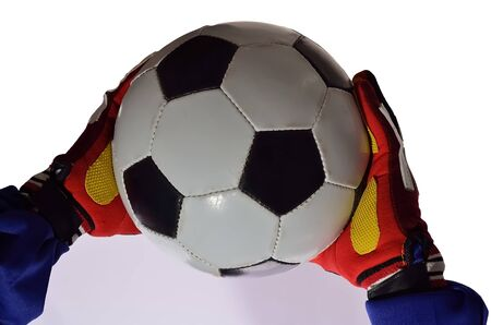 portero de futbol: Portero de f�tbol atrapar pelota para salvar a su equipo con las manos en el fondo blanco.