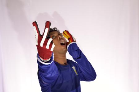 soccer goalkeeper: Soccer goalkeeper in shouting white background.