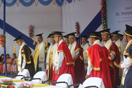 enters: Patna, India - August 6, 2015: Convocation procession is entering at the dias. The procession enters and convocation starts.