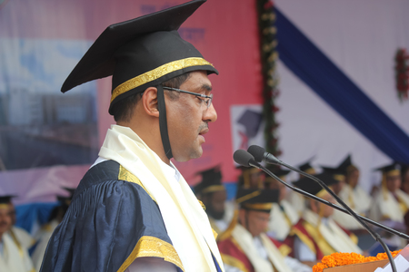 organized group: Patna, India - August 6, 2015: Prof, Pushpak Bhattacharya, Director, IIT Patna is delivering lecture during annual convocation 2015. The ceremony was held at IIT Patna campus. IIT is one of the primium institutes and institute of nationa importance in Ind Editorial