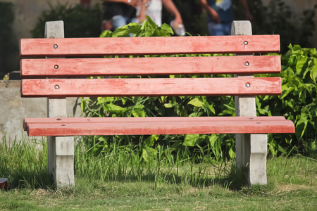 empty bench: Empty bench in a park. Stock Photo