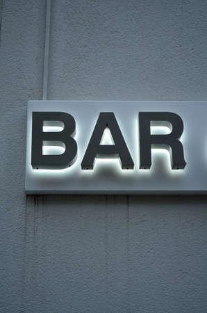 western script: Bar text on a wall.