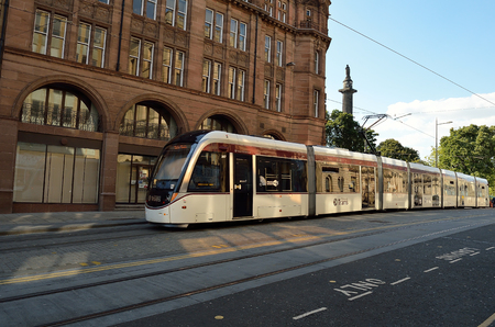lothian: Edinburgh Tram is running on a road.